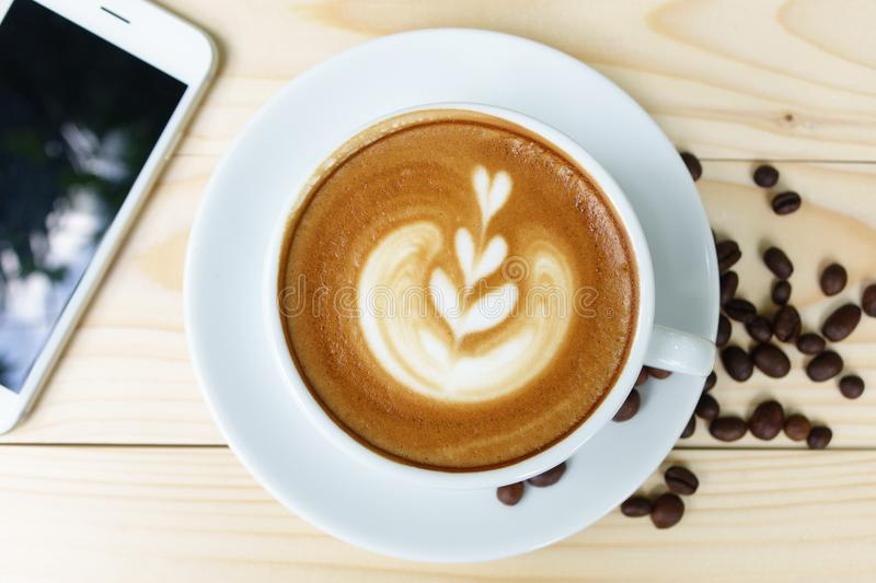 Coffee cup with on wooden table royalty free stock photography