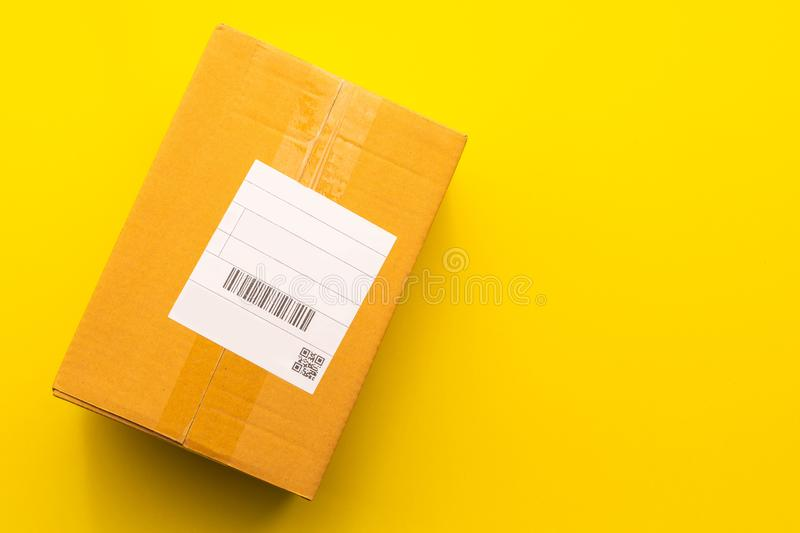Top view empty brown post or carton box on yellow paper background. Online order and delivery concept royalty free stock photos