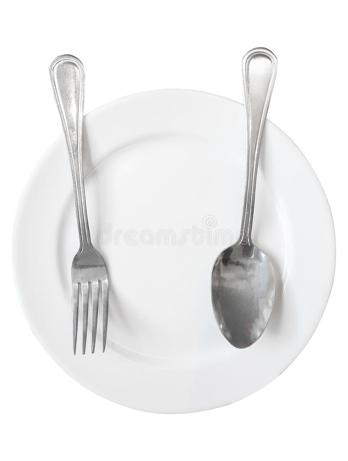 Top view,Empty ceramic round plate with fork and spoon isolated white background stock photo