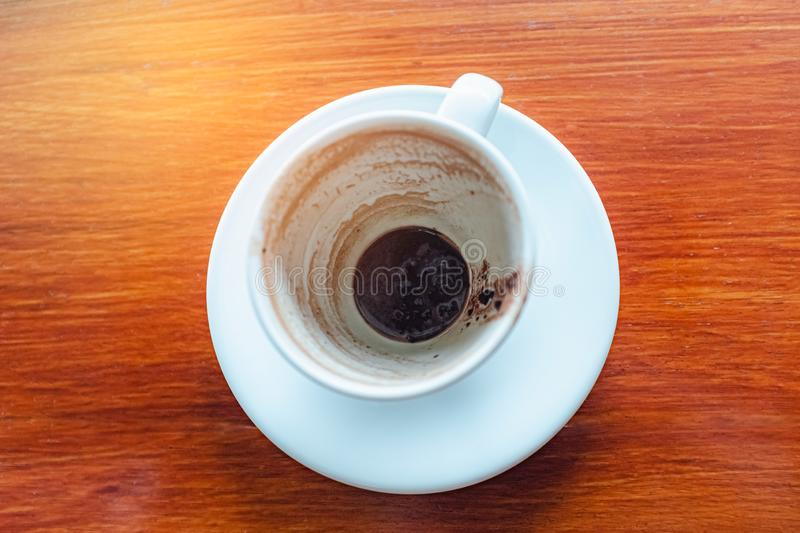 Empty hot coffee cup after drink on wood table background. Top view of empty hot coffee cup after drink on wood table background royalty free stock photos