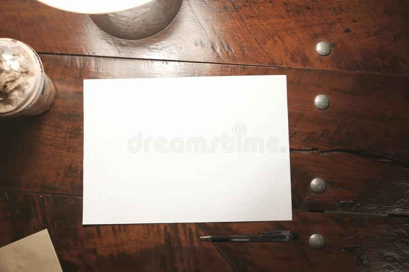 Top view empty paper on old wood table vintage style stock image