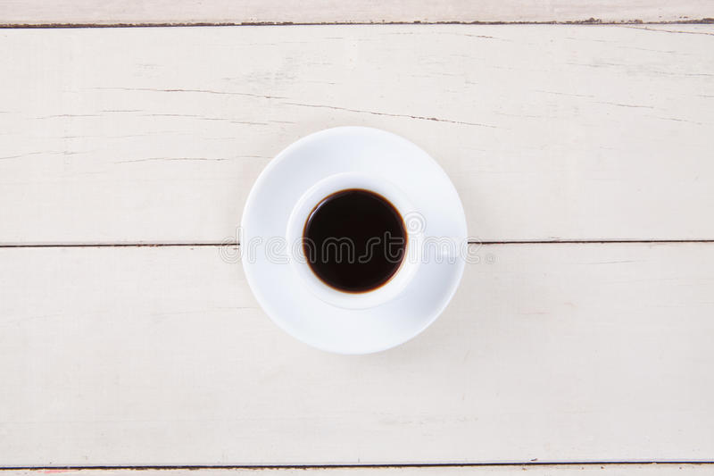 Top view of empty white cup coffee with black coffee put on table royalty free stock photo