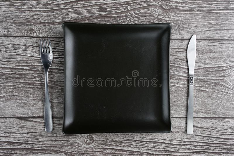 Top view empty white plate setting with wood background. Pace for text royalty free stock photo