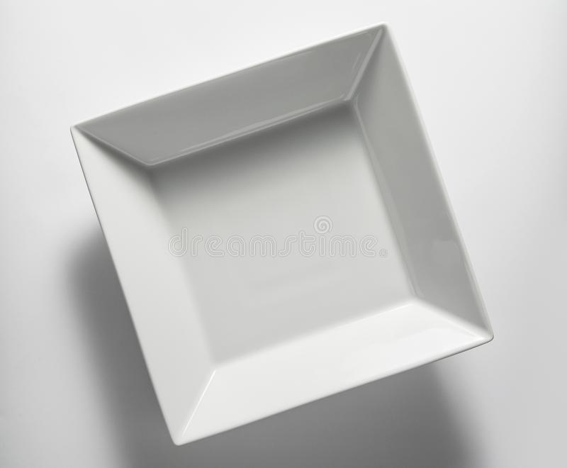Top view of empty white square plate stock images