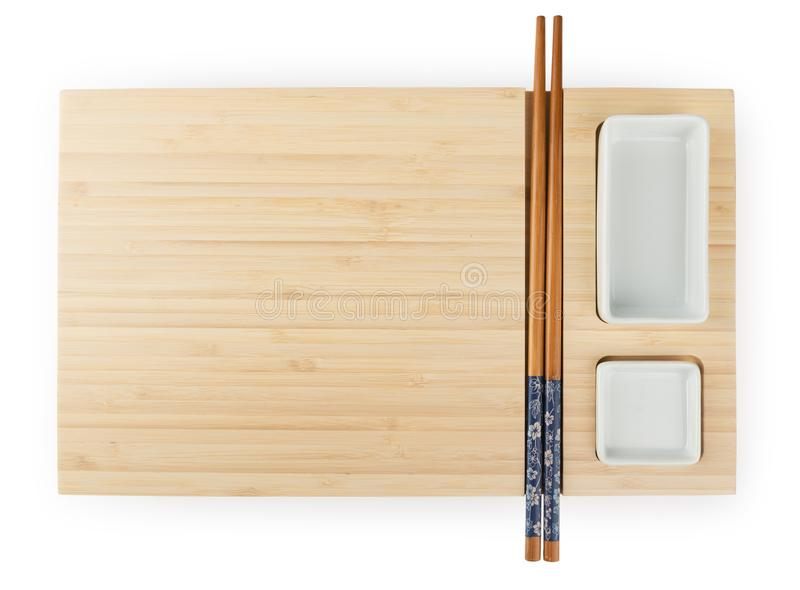 Top view of empty wooden bamboo sushi board with chopsticks and stock photography