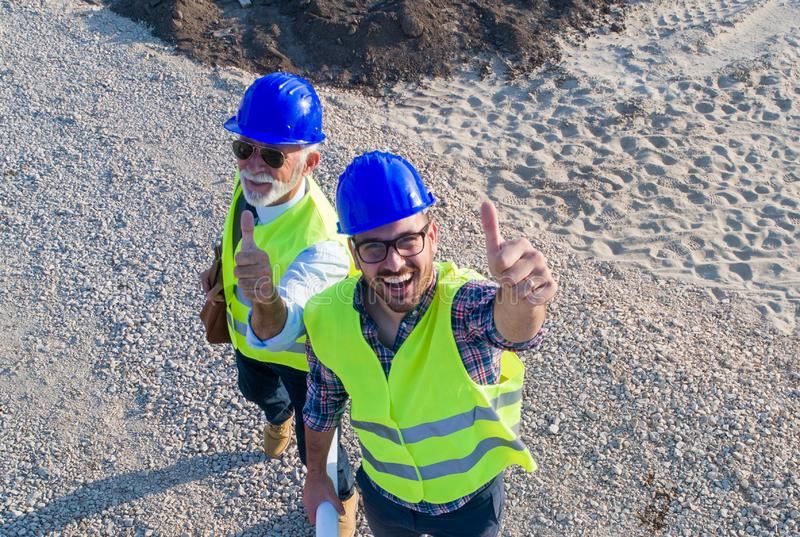 Top view of engineers at construction site royalty free stock photography