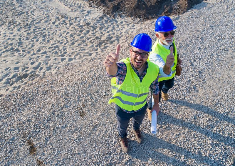 Top view of engineers at construction site stock image