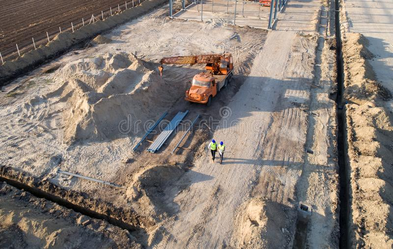 Top view of engineers at construction site stock photo
