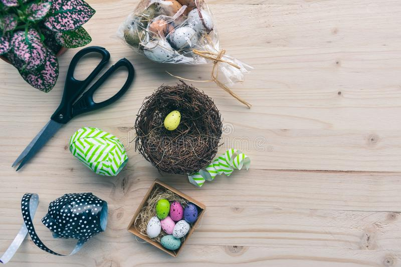 Top view of accessories for making an colorful Easter eggs nest, flat lay royalty free stock image
