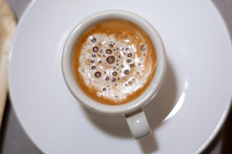 Top view of espresso coffee in a white cup on a saucer stock photos