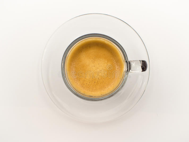 top view espresso shot in clear glass and saucer royalty free stock photo