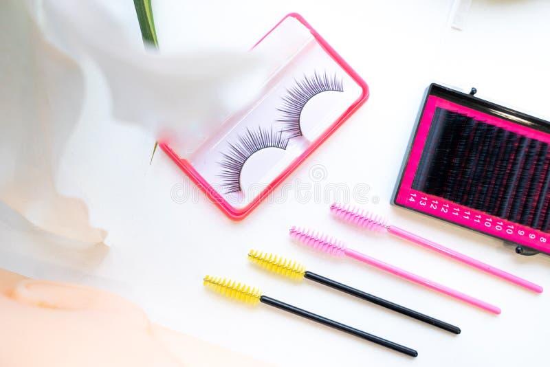 Top view Eyelash extension tools on white background, brush lash. Comb, Micro Eyelash Brushes Mascara Wan, fake eyelashes stock image