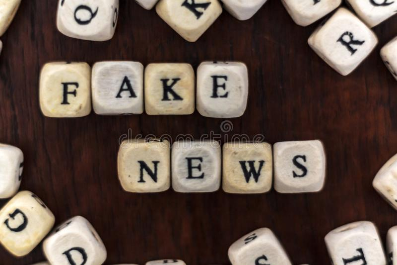 Top view of fake new written on wooden cubes stock photo