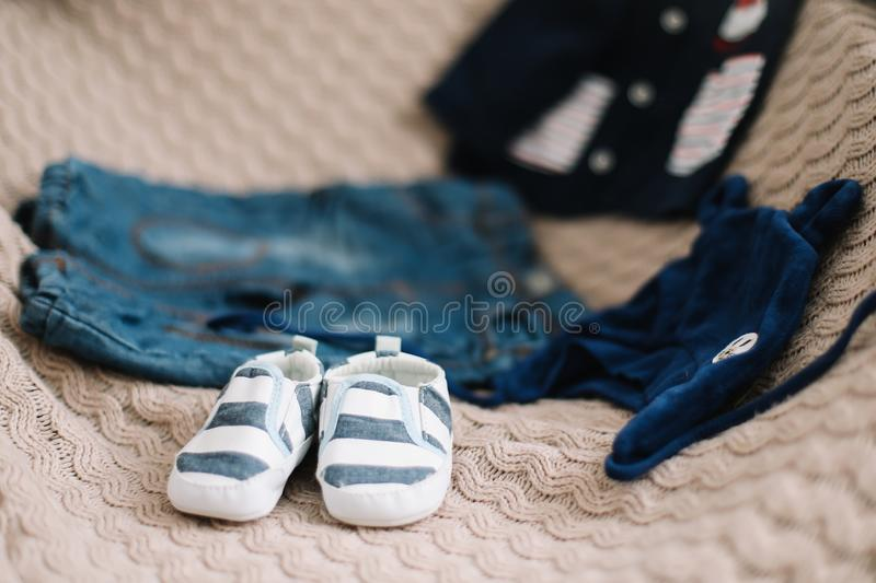 Top view fashion trendy look of baby clothes, fashion concept.  A pair of baby boy shoes royalty free stock photo