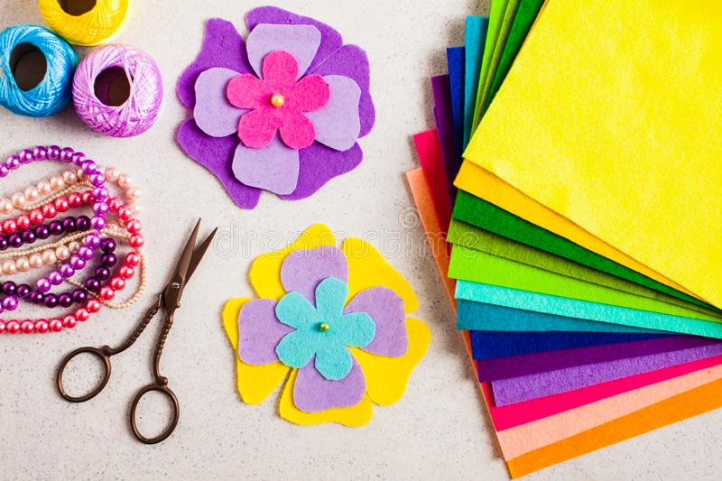 Top view of felt decorations, scissors and beads. Kids DIY crafts tutorial stock photo