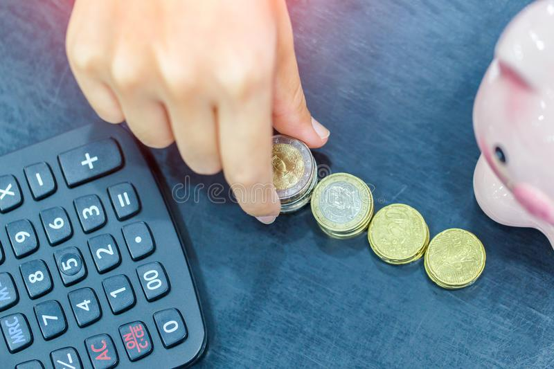 Top view female hand stack euro coins to shown concept of growing business and wealthy stock photos