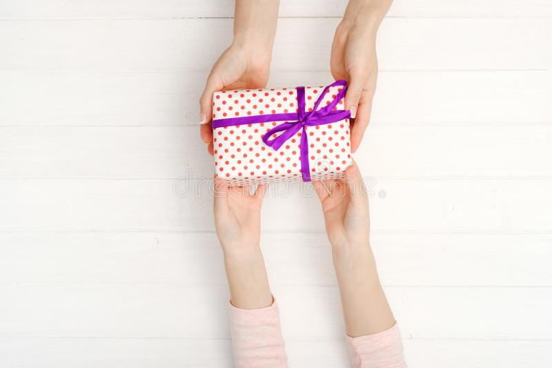 Girls hands holding lovely present box royalty free stock photo