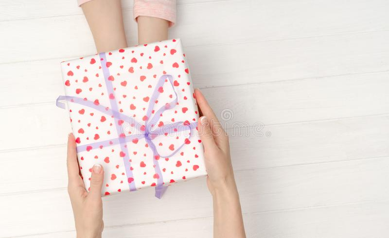 Girls hands holding lovely present box royalty free stock images
