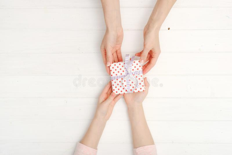 Girls hands holding lovely present box royalty free stock image