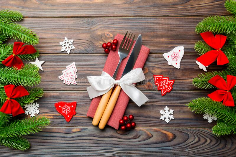 Top view of festive cutlery on new year wooden background. Close up of christmas decorations. Holiday dinner concept.  stock image