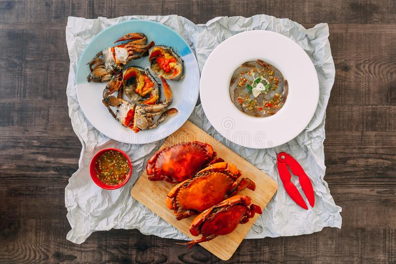 Top view of Fish Sauce-Fermented raw Prawns and Sea Crab with Pickled Crab Eggs and Steamed Giant Mud Crabs. stock photography