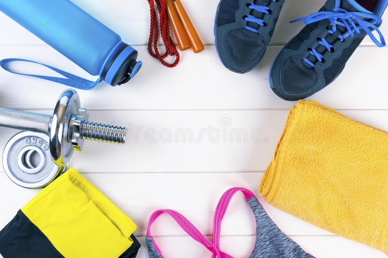 Top view with fitness equipment on white wooden background royalty free stock photo
