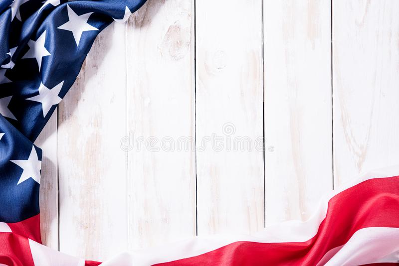 Top view of Flag of the United States of America on white wooden background. Independence Day USA, Memorial.  royalty free stock photo