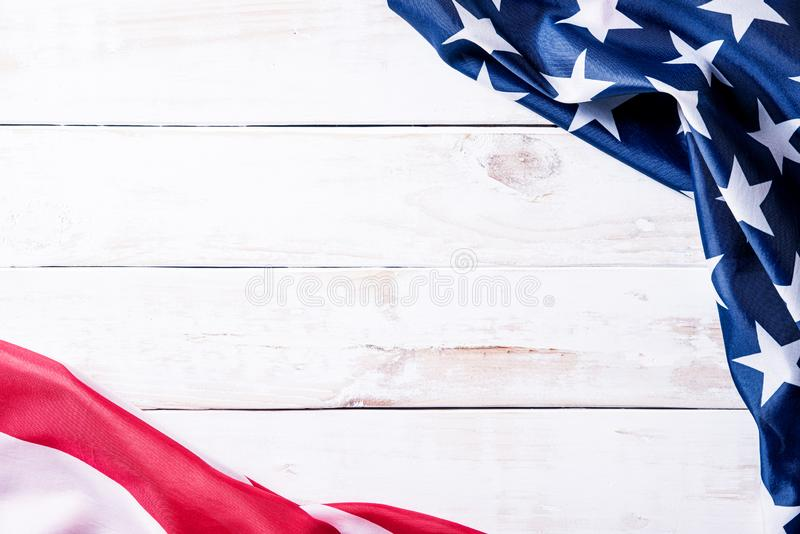 Top view of Flag of the United States of America on white wooden background. Independence Day USA, Memorial.  stock photography