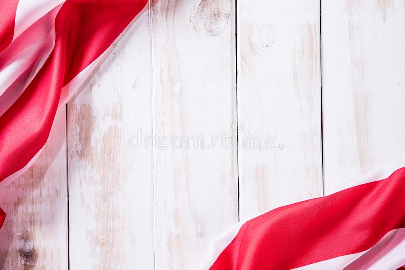 Top view of Flag of the United States of America on white wooden background. Independence Day USA, Memorial.  stock photos