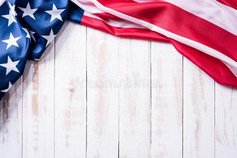 Top view of Flag of the United States of America on white wooden background. Independence Day USA, Memorial.  royalty free stock image