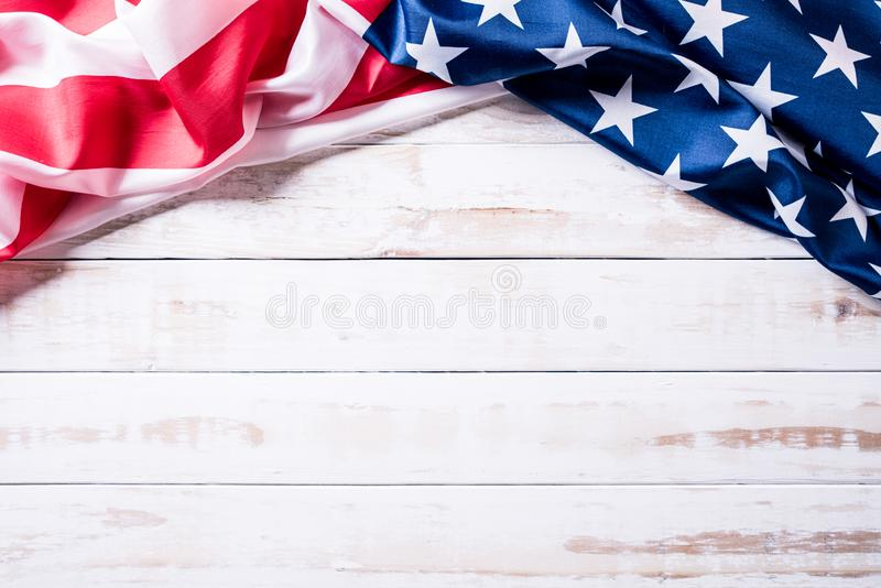 Top view of Flag of the United States of America on white wooden background. Independence Day USA, Memorial.  royalty free stock images