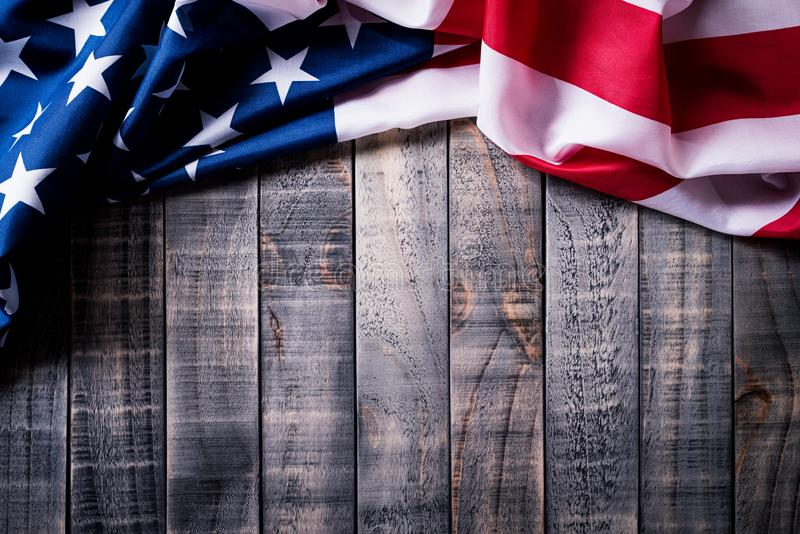 Top view of Flag of the United States of America on wooden background.  Independence Day USA, Memorial.  royalty free stock photography