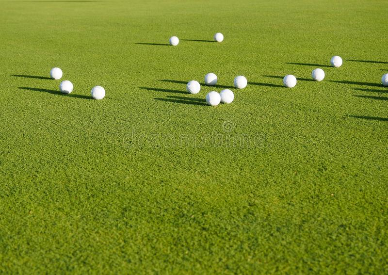 top view flat lay of golf balls on grass background, the concept of a sport for the rich, luxury, fitness, game royalty free stock images