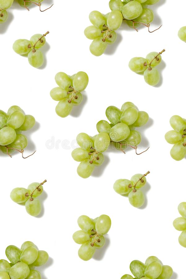 Top view flat lay green grapes pattern isolated on white background. Vegetarian food concept, wine stock photos