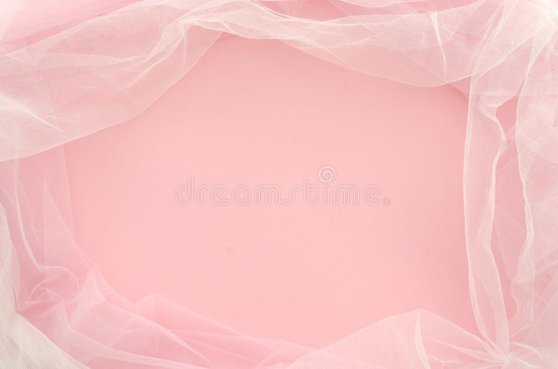Top view. Flat lay minimal concept. Frame made of duotone tulle on pink background with copy spase for lettering. Mockup royalty free stock photography
