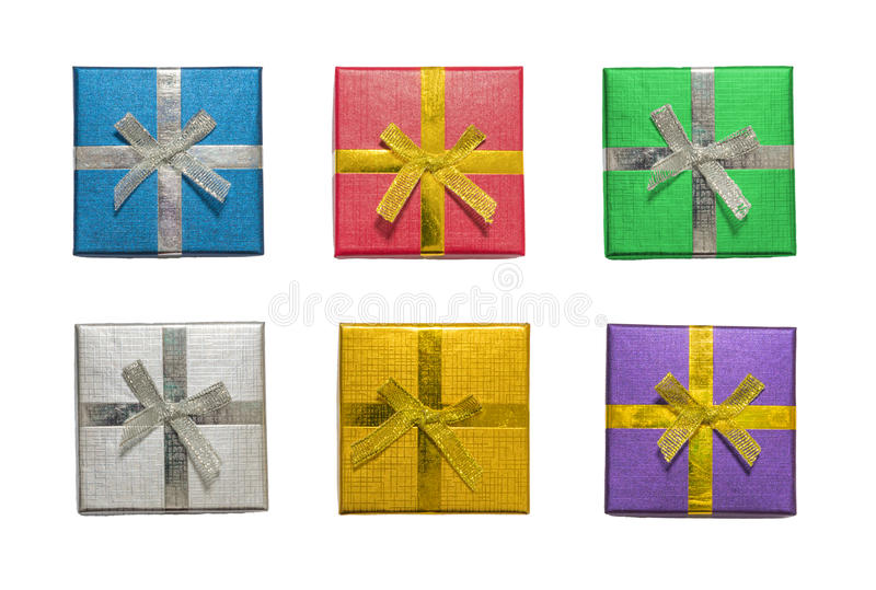 Top view or flat lay of various shiny colorful blue, red, green, silver, gold, purple christmas gift or present boxes, isolation stock photo