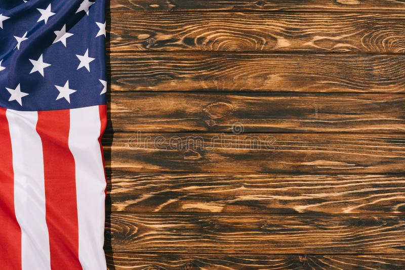 Top view of folded american flag on wooden tabletop, americas independence. Day concept stock photography