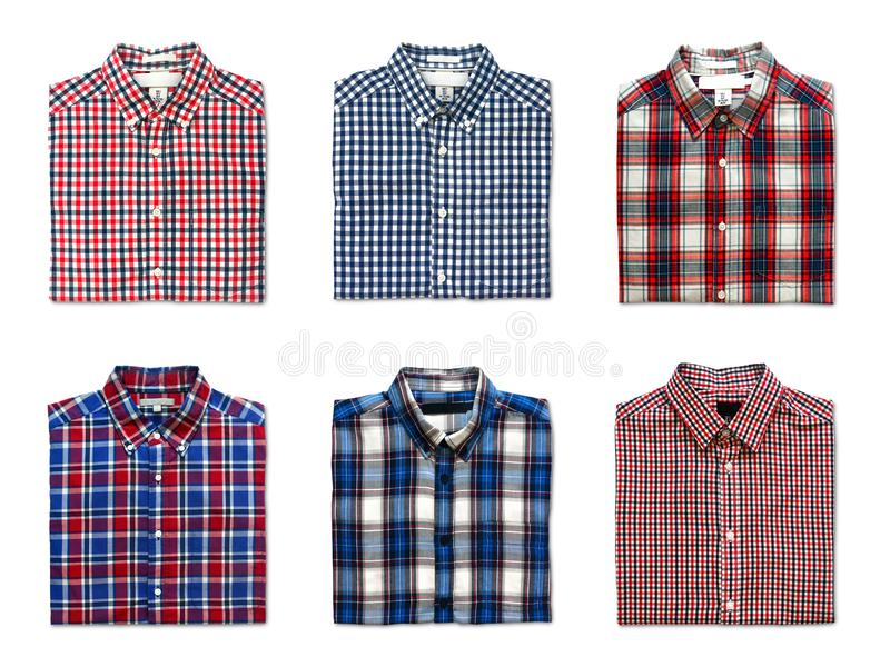 Top view of folded red, blue and white color long sleeve plaid shirts isolated on white background stock images