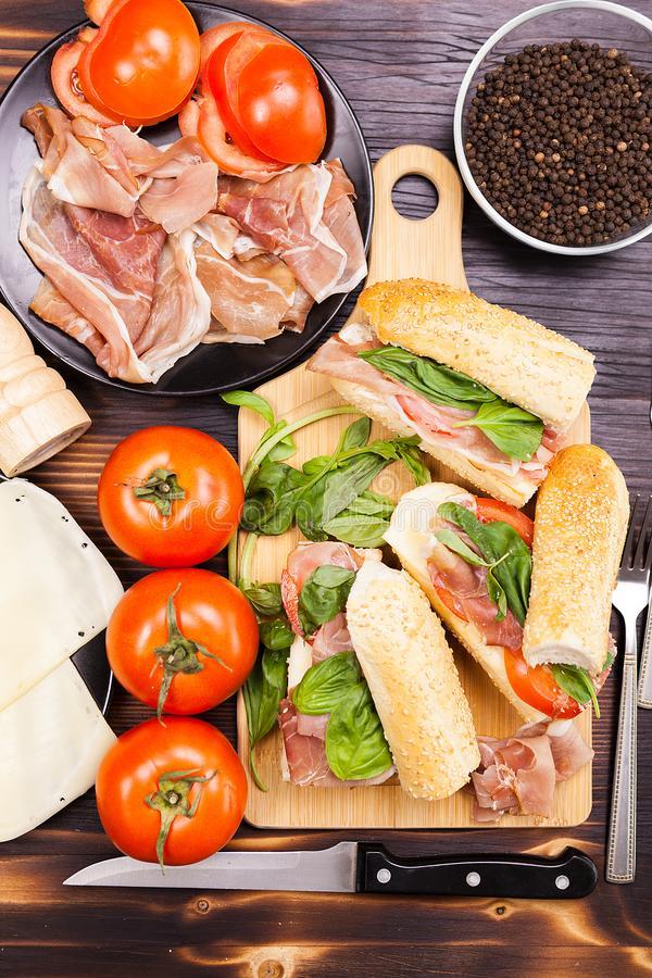 Top view of four healthy and delicious sandwiches on wooden boar stock photos