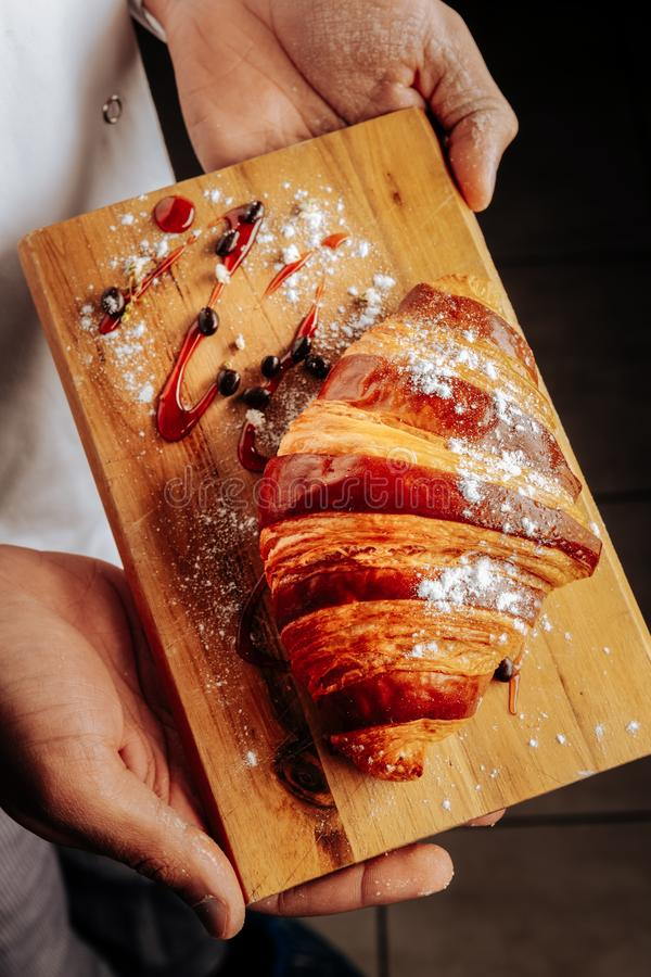 Top view of French croissant with jam and sugar powder stock image
