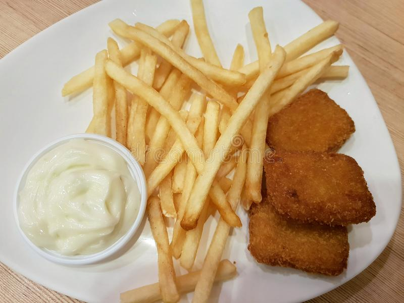 Top view of french fries, fish nuggets. stock photos