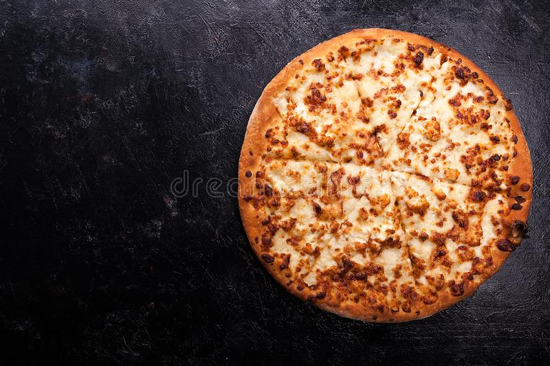 Top view of fresh baked pizza on dark wooden background royalty free stock photos