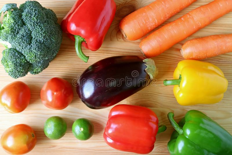 Top view of fresh colorful vegetables on wooden background. Healthy eating stock photography
