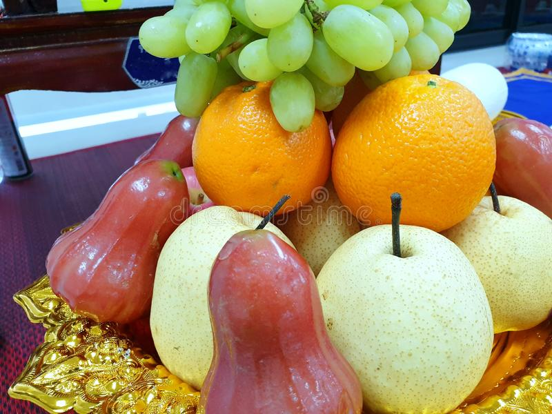 Top view of fresh green grape, rose apple, orange and Chinese pear stock photo