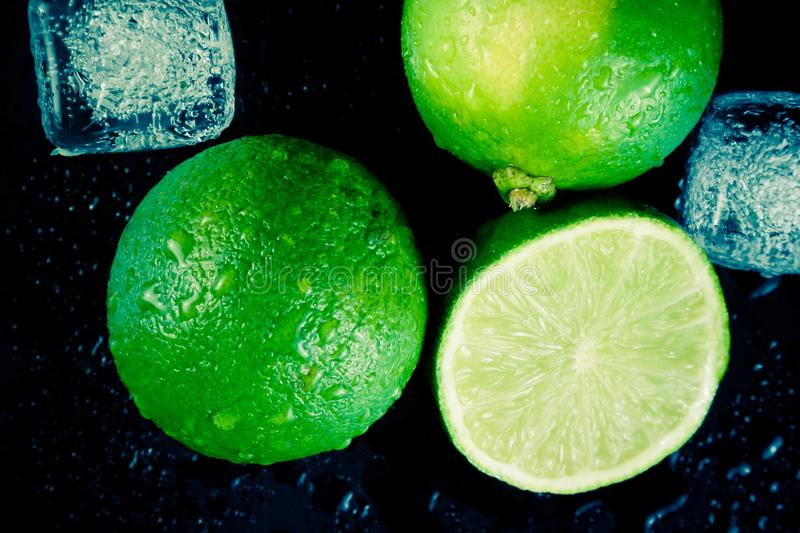 Top of view of fresh lime with ice cubes royalty free stock photos