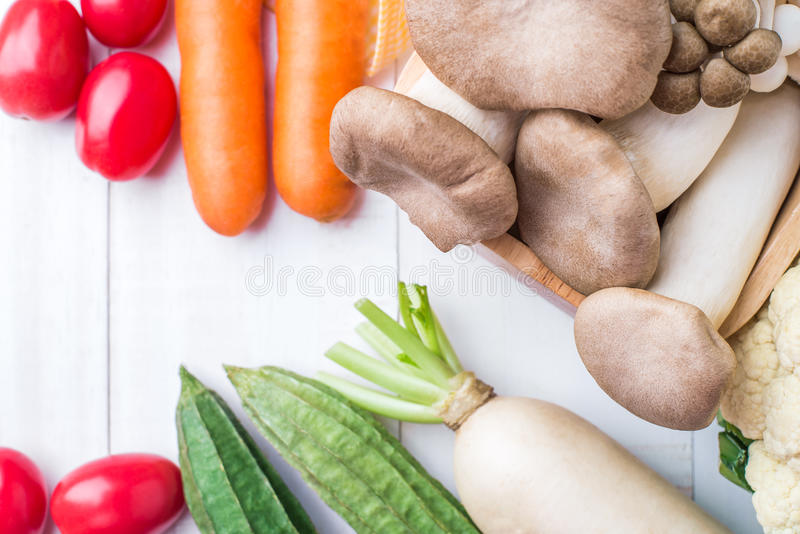 Download Top View Of  Fresh Organic Vegetables On White Wooden Table Back Stock Image - Image: 83708257
