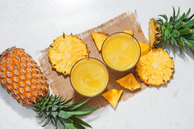 Top view of fresh pineapple juice in the glass with pineapple fr. Uit stock photos