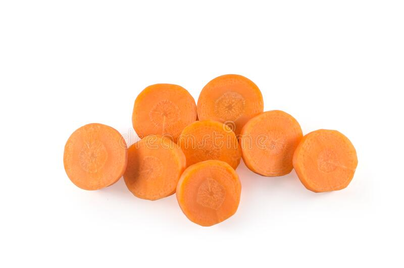 Top view of fresh red carrot slices on white background royalty free stock photo