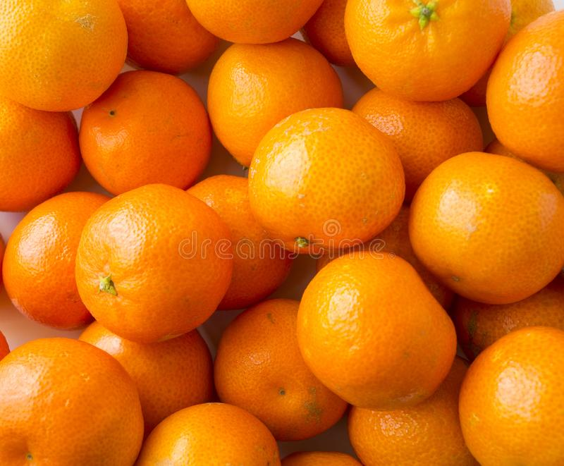 Top view. Fresh tangerines. Ripe and tasty mandarins. Clementines. royalty free stock images