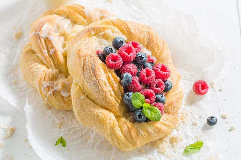Top view of fresh yeast cake with raspberries and blueberries stock image